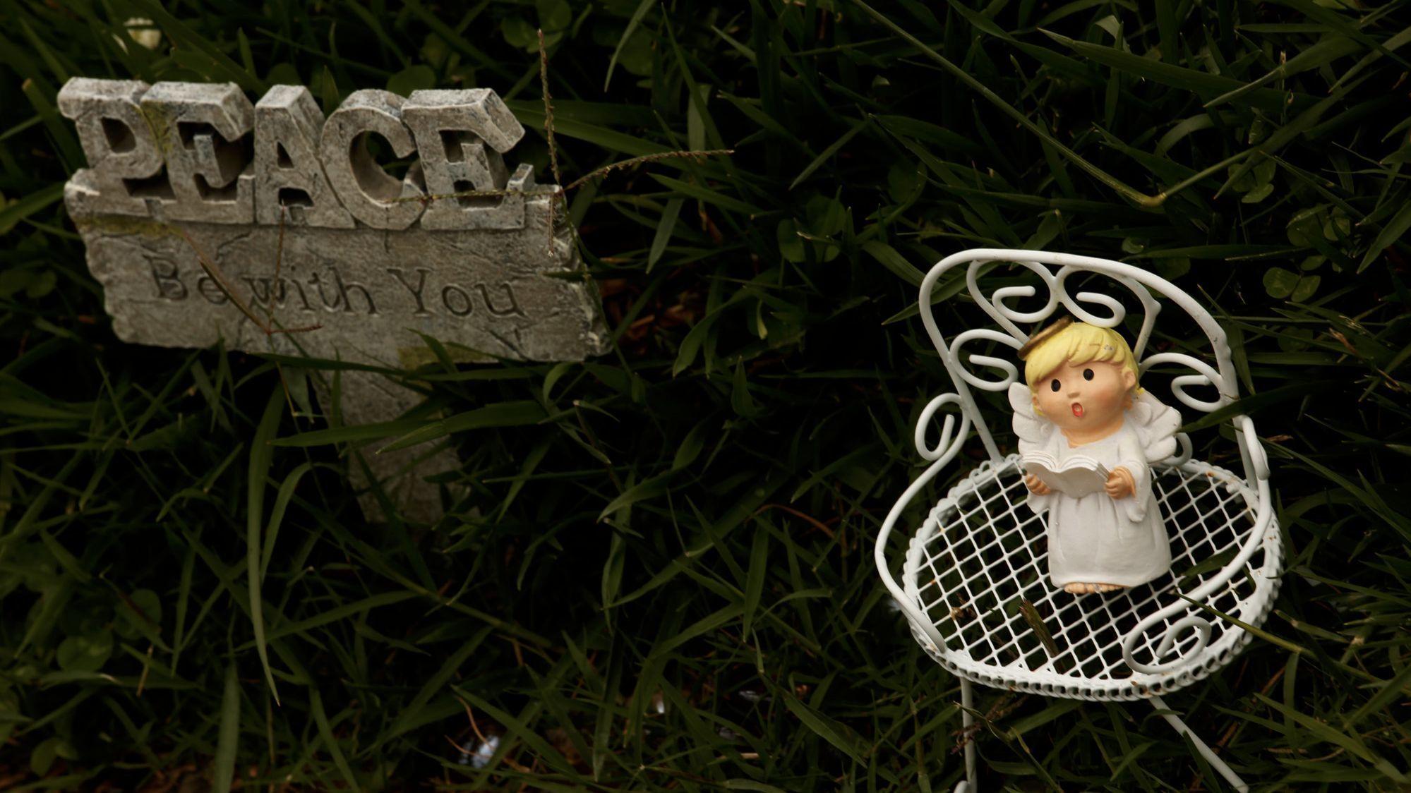 A small angel rests near the gravesite of Bree'Anna Guzman.