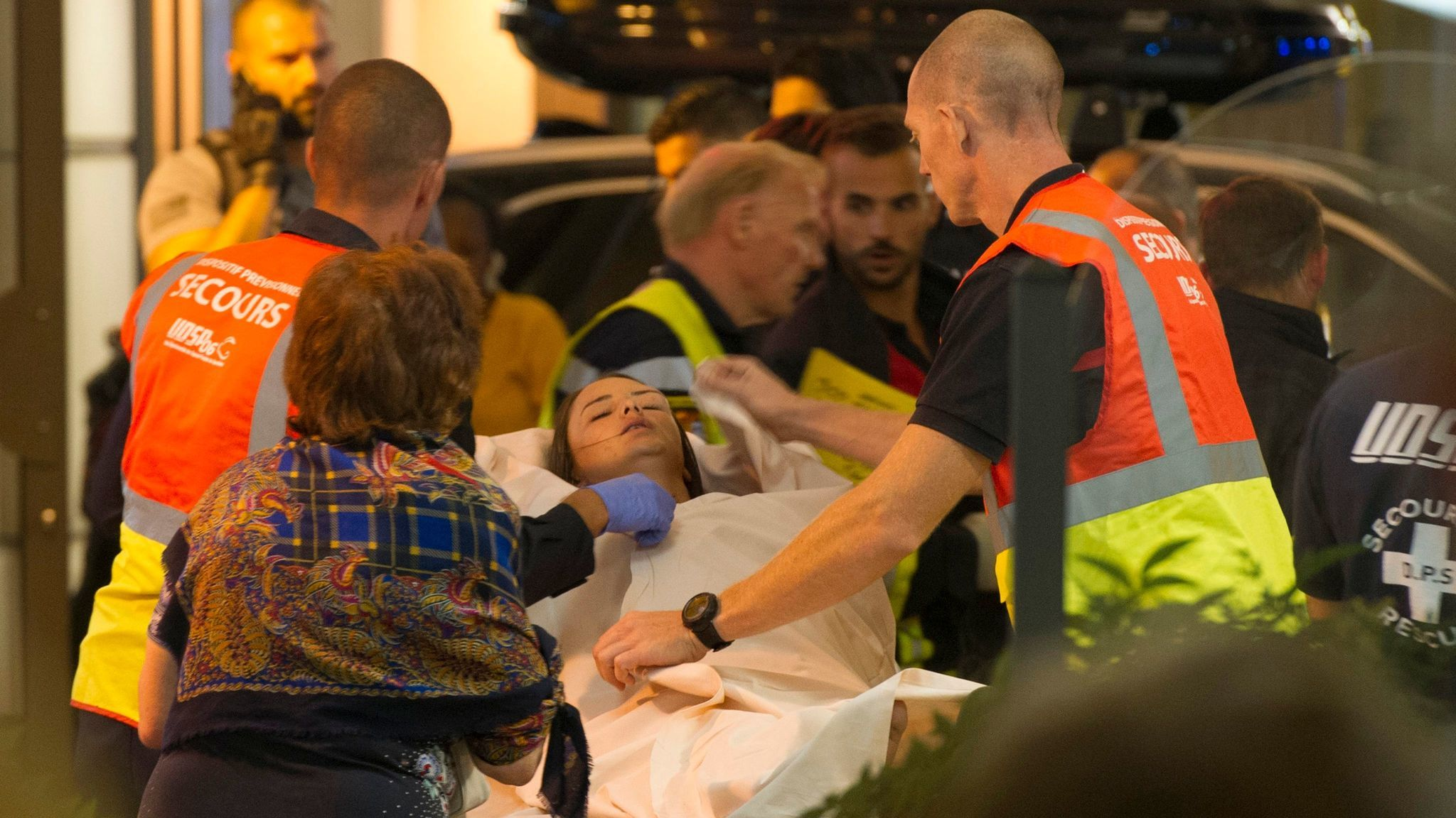 Wounded bystanders are evacuated after a truck crashed into the crowd during Bastille Day celebrations in Nice, France, on July 14, 2016.