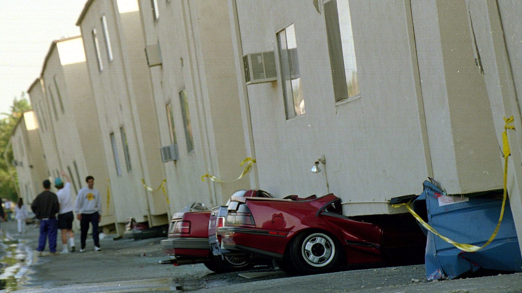 An apartment in Canoga Park on Victory Boulevard collapses on its flimsy ground story during the 1994 Northridge earthquake.