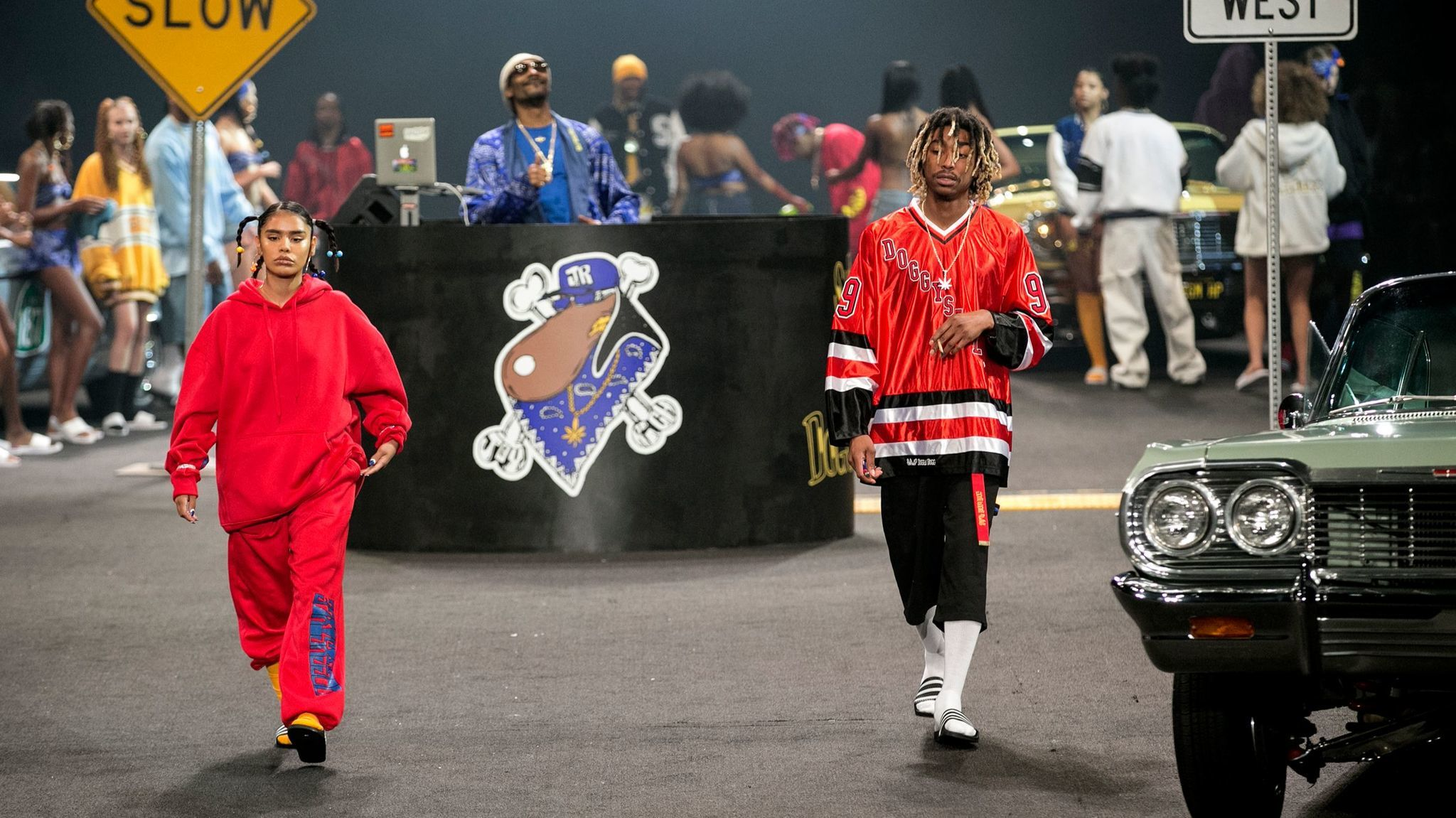 Snoop Dogg (center) performs during the Joyrich X Snoop Dogg fashion show on June 10, 2017, at L.A. Live's Event Deck in downtown Los Angeles.