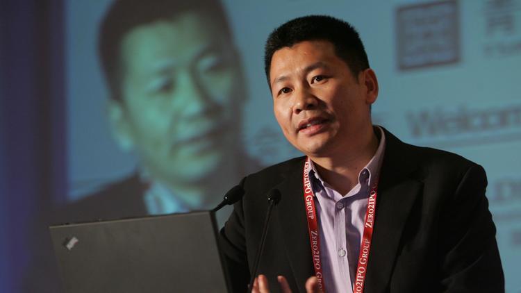 Zhou Chengjian, chairman and president of Metersbonwe Group, speaks during a forum in Shanghai in De