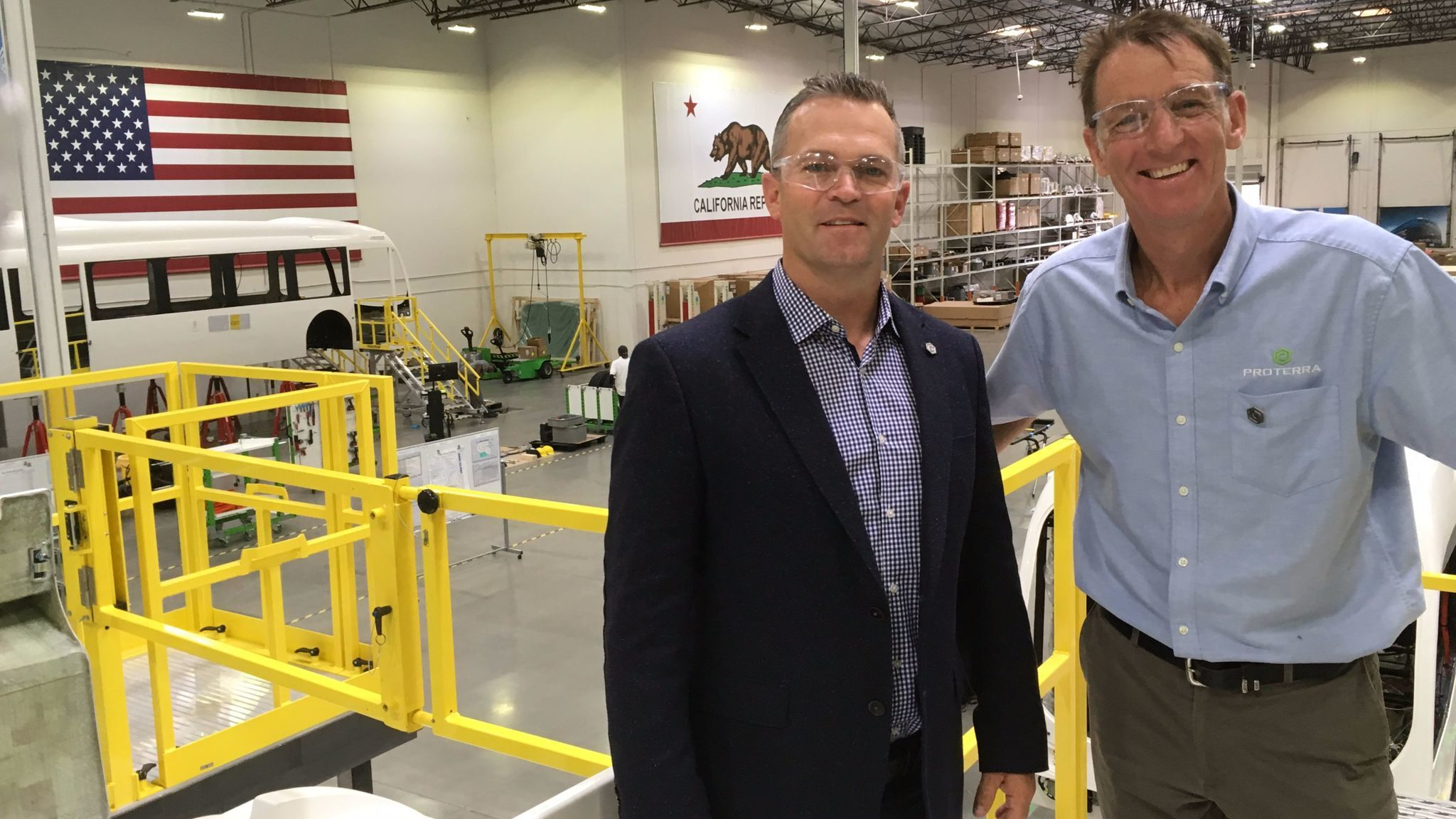 Josh Ensign, Proterra chief operating officer, with Paul Mottram, plant manager.