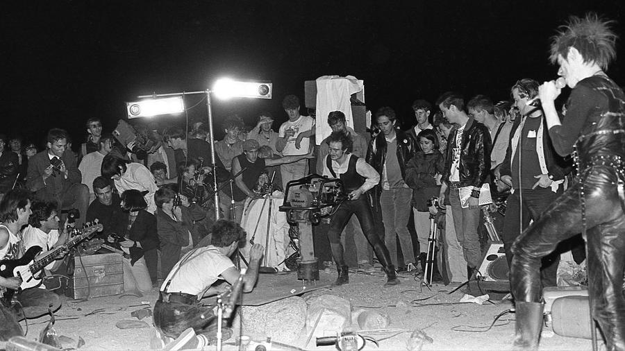 Einstürzende Neubauten performs at Desolation Center in the Mojave Desert in 1984 — the subject of an exhibition at Cornelius Projects.