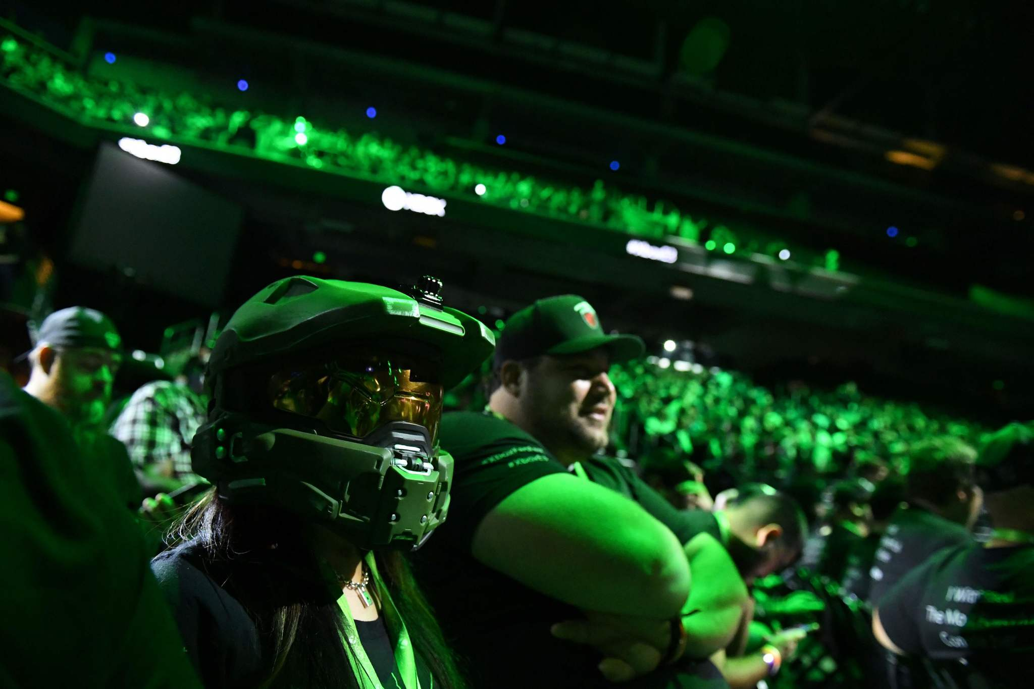 """An attendee wears the helmet of Master Chief from the """"Halo"""" franchise during a Microsoft at the Galen Center in Los Angeles in June."""