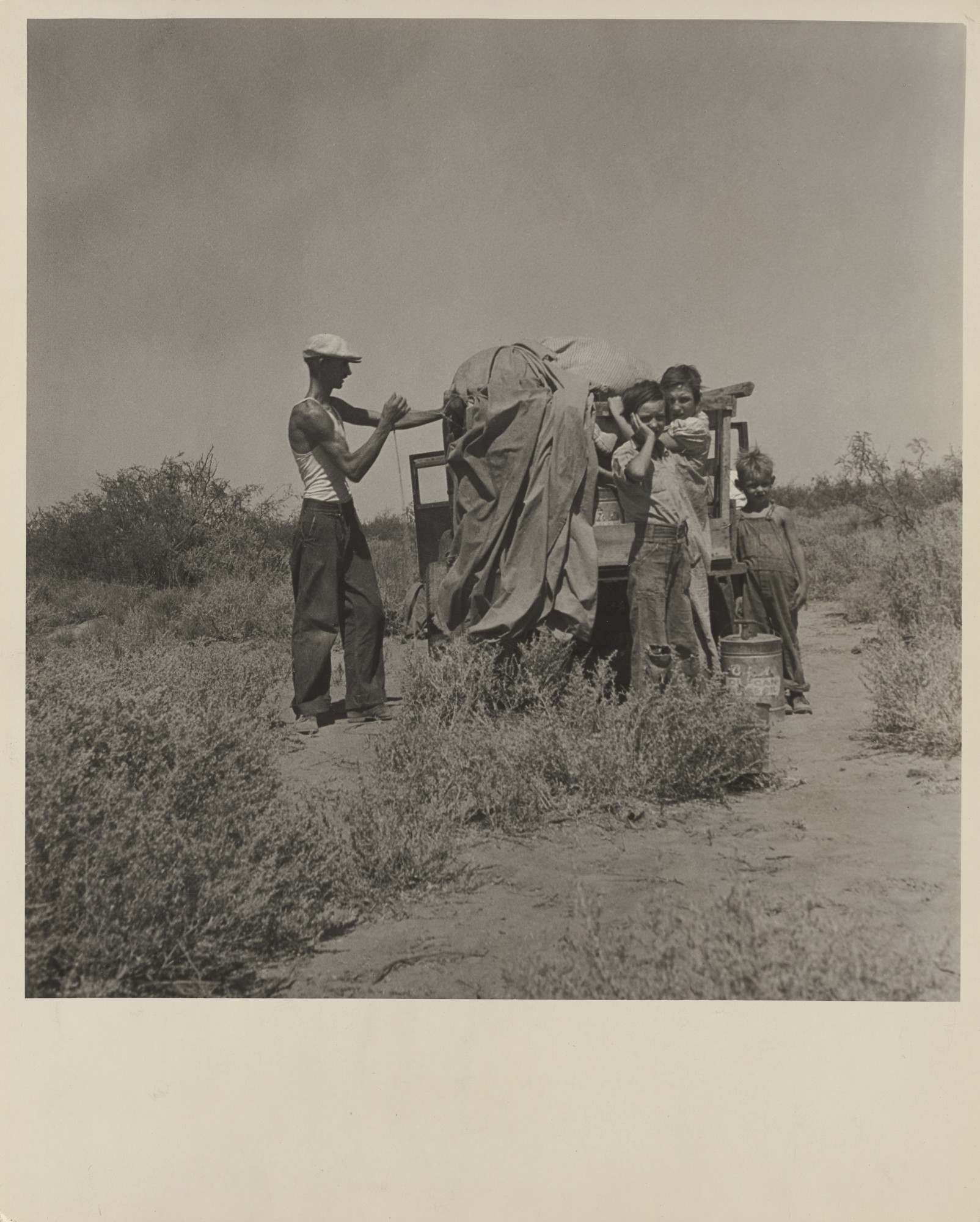 """Dorothea Lange's """"Transients, New Mexico, negative about 1935; print before 1938."""""""