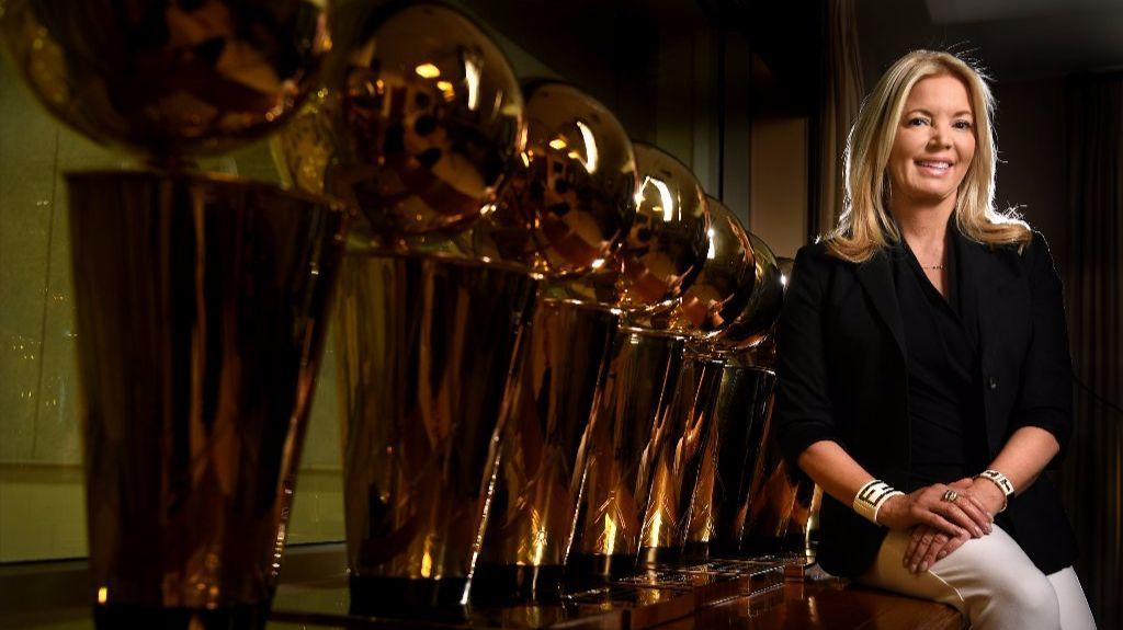Jeanie Buss sits next to NBA championship trophies in her El Segundo office.