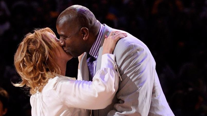 Jeanie Buss and Magic Johnson embrace each other during the Lakers' 2009 NBA championship ring presentation on Oct. 27, 2009.