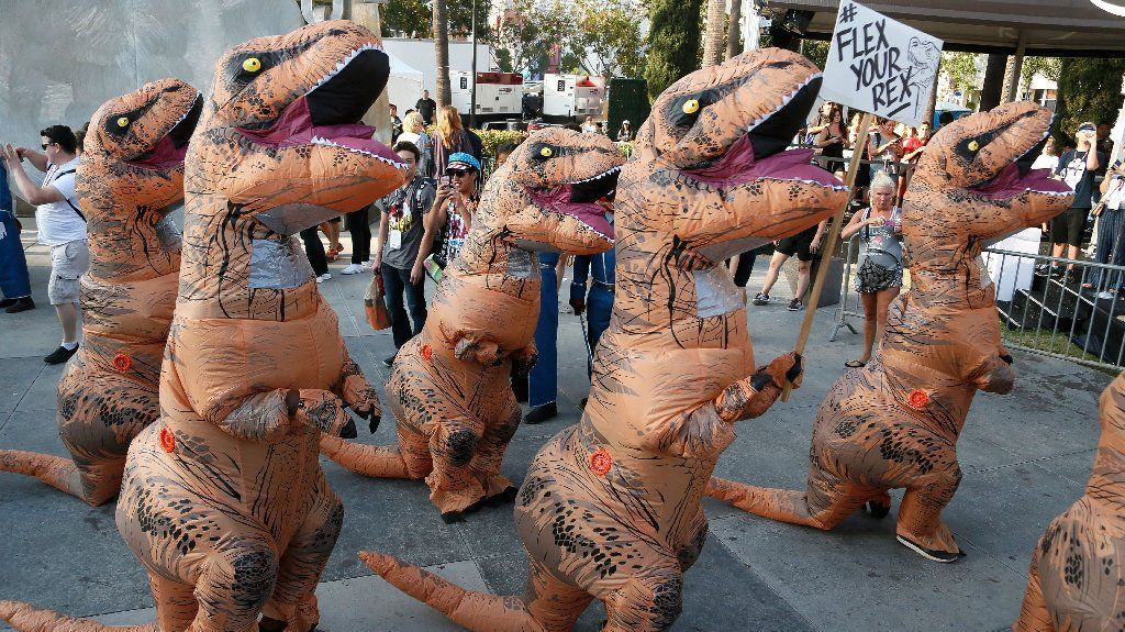 T-Rex participate in the Zombie Walk at San Diego Comic-Con 2016. The Zombie Walk returned to the SDCC two years after a woman was hit and seriously injured by a driver who drove into the crowd. This is the walk's 10th year. #sdcc2016