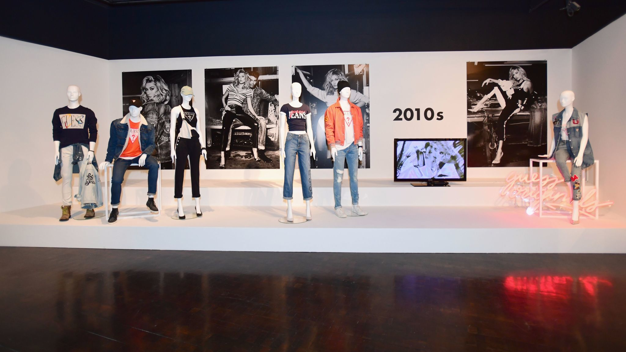One part of the Guess exhibit showcases looks from each decade.