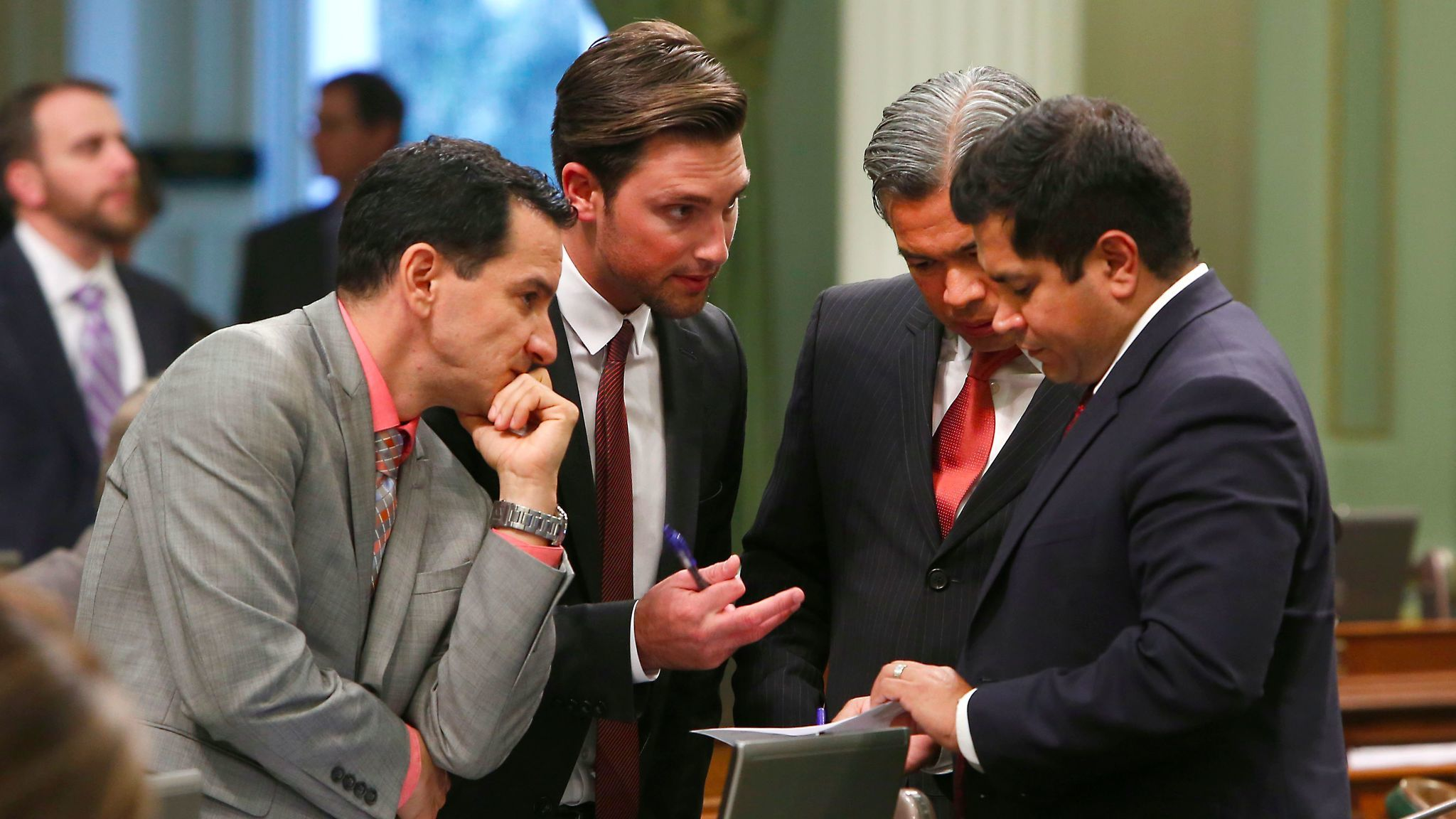 Democratic Assembly members, from left, Anthony Rendon, Ian Calderon, Rob Bonta and Jimmy Gomez huddle during the 2015 session.