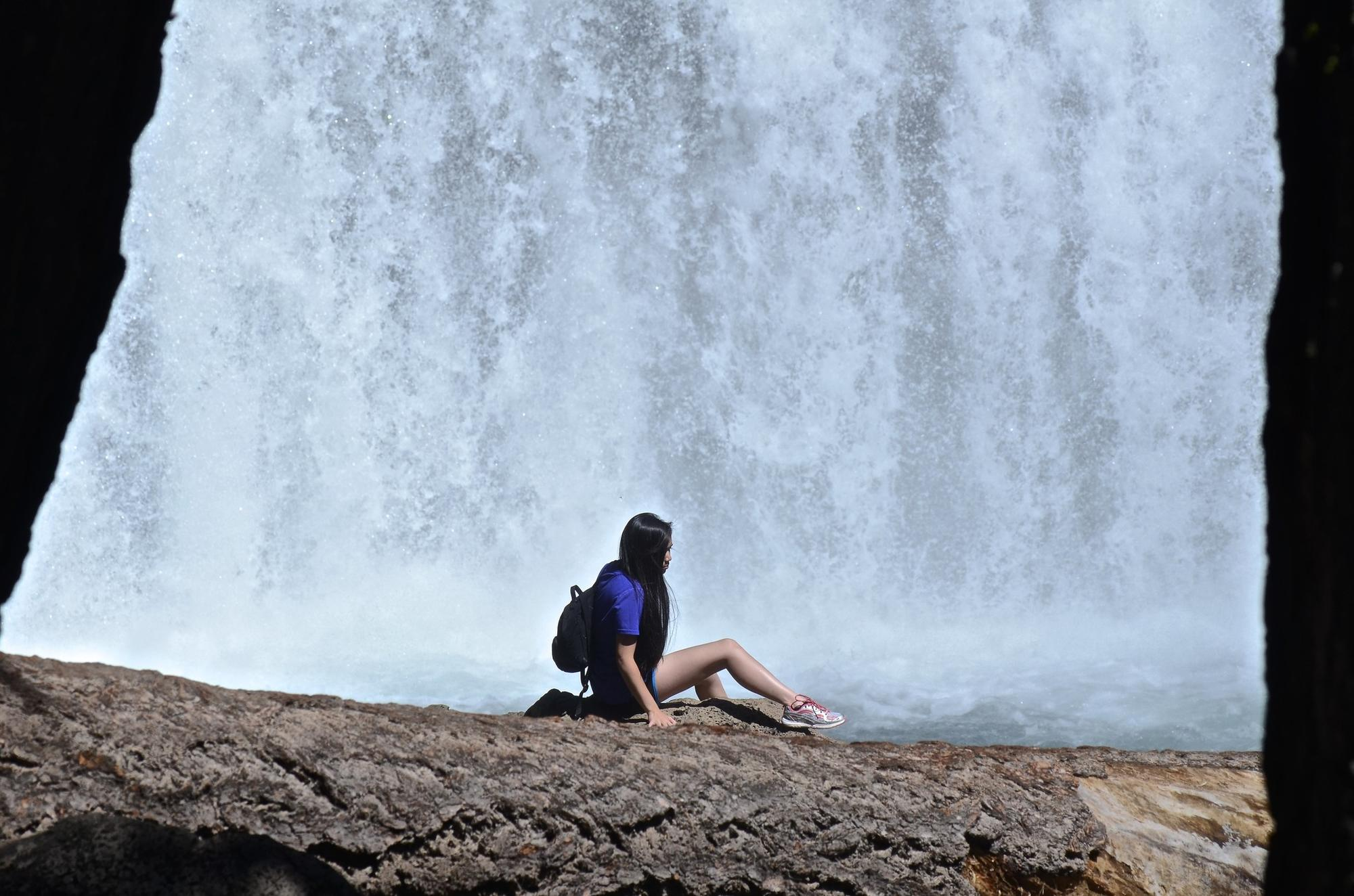 Hiker at Northern California's McCloud Falls, Middle Fall.