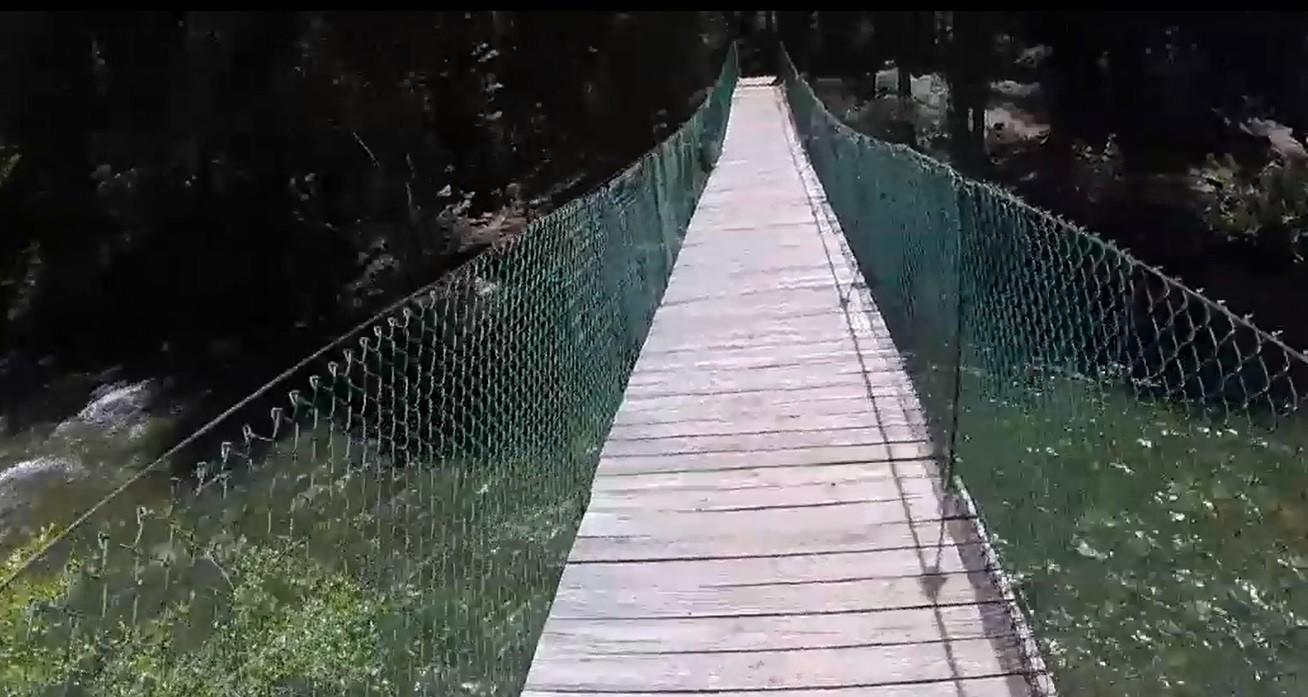 A suspension bridge crosses the Sacramento River at Castle Crags State Park, Calif.