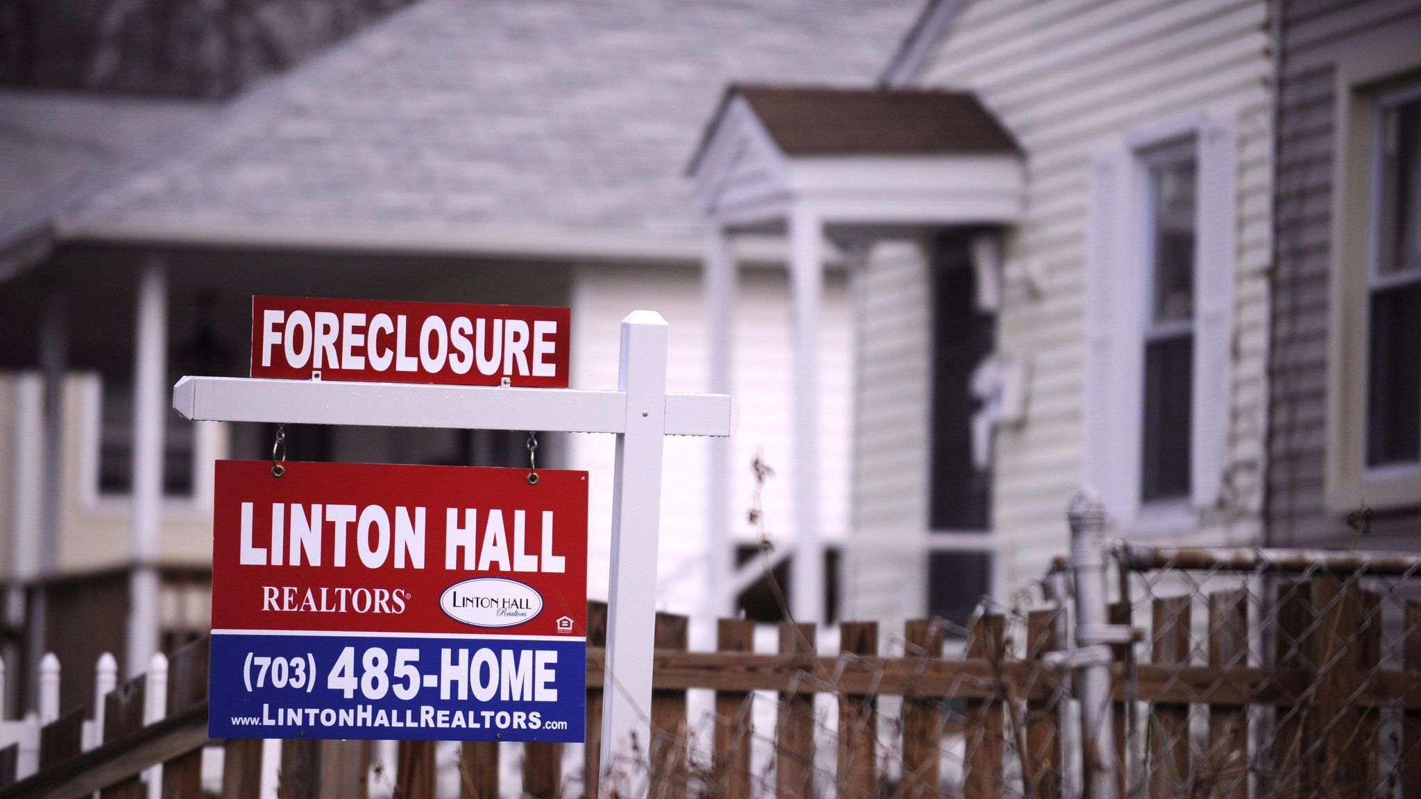 A foreclosure sign is posted in the front of a house in Alexandria, Va., in December 2008.
