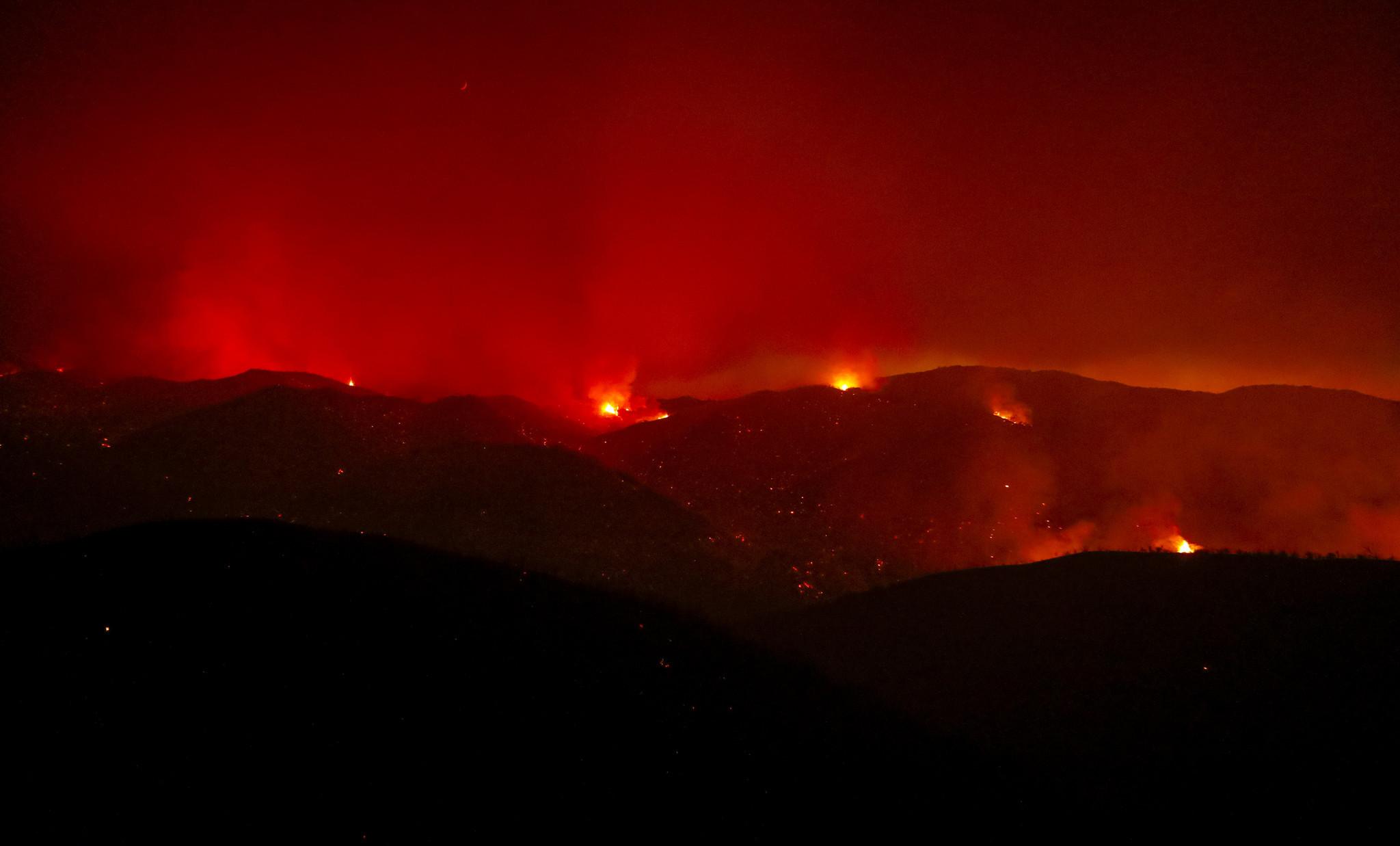 The Hill fire burns near Huer Huero Road in Santa Margarita on Monday.