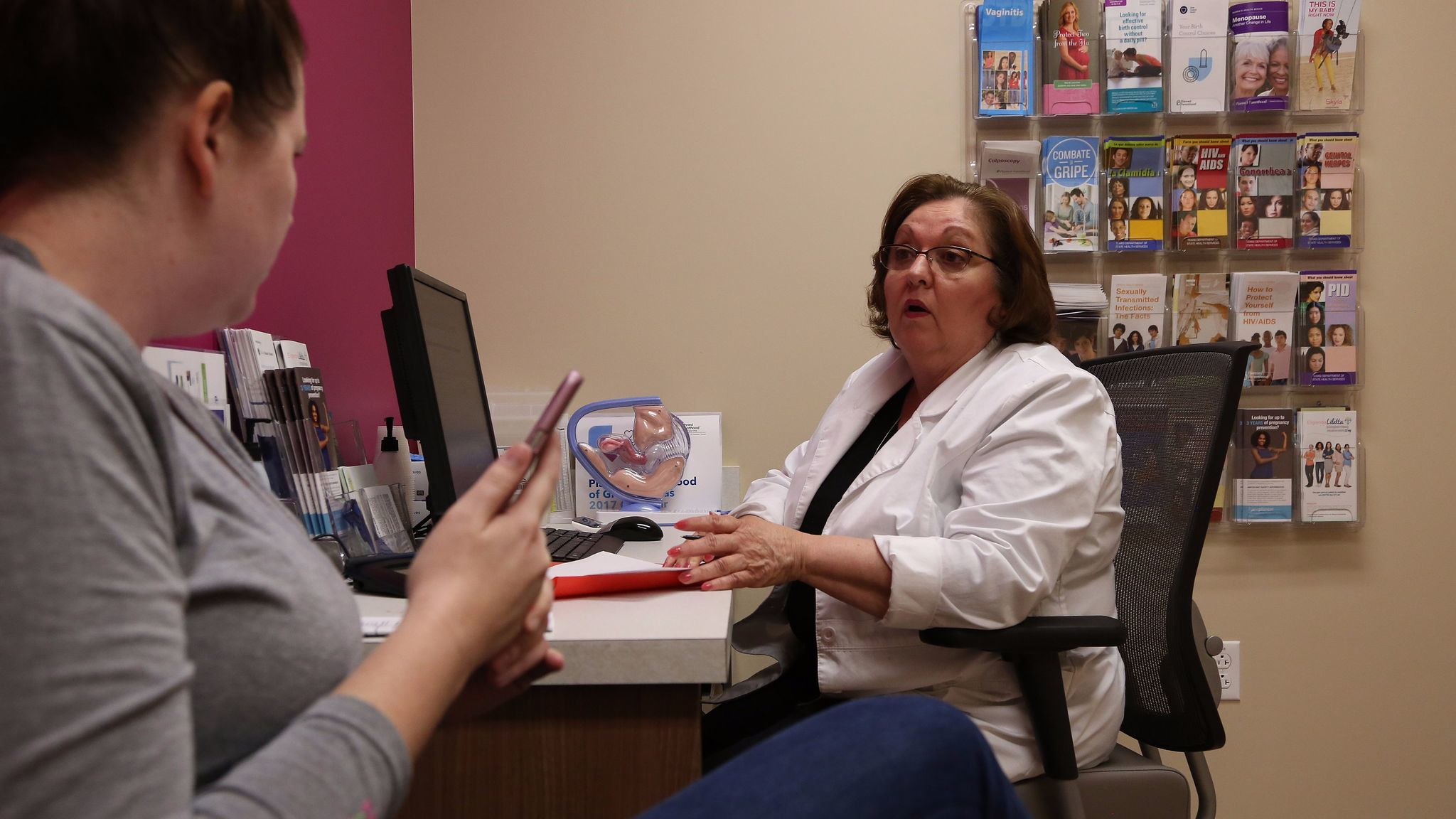 Vivian Bigelow, a nurse practitioner, discusses birth control options with a patient at a Planned Parenthood health center in Plano, Texas.  The Republican healthcare plans would prohibit Medicaid recipients from using their benefits at Planned Parent facilities for one year.
