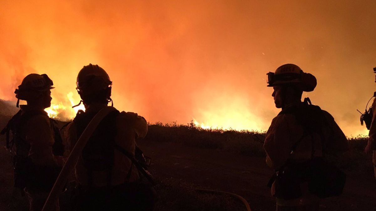 Crews face off with the Christianitos fire near Camp Pendelton.