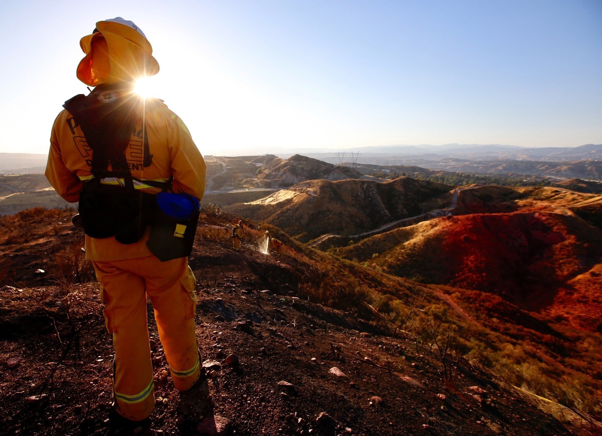 A battalion chief with the Pasadena Fire Department watches his crew. Firefighters were battling a fast-moving brush fire in the Santa Clarita area that burned 760 acres and prompted the shutdown of Highway 14 in both directions June 25, 2017.