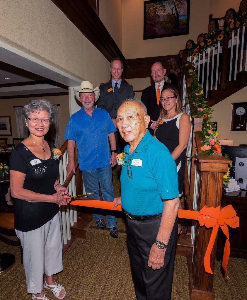 Sunrise of Sabre Springs residents Mr. and Mrs. Wan helped cut the ribbon at the open house on June 22, along with visiting Poway Mayor Steve Vaus, Todd Smith, regional director of operations, Chris Winkle, chief executive officer of Sunrise, and Shauna Klemp, executive director.