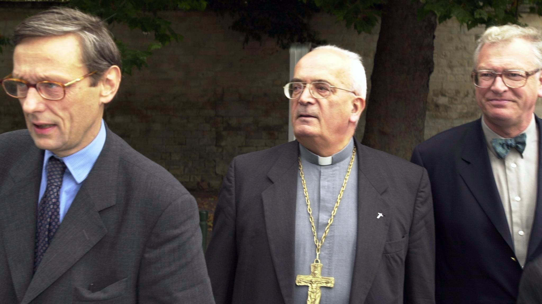 Bishop Pierre Pican, center, flanked by lawyers outside the Caen court house in France in 2000.