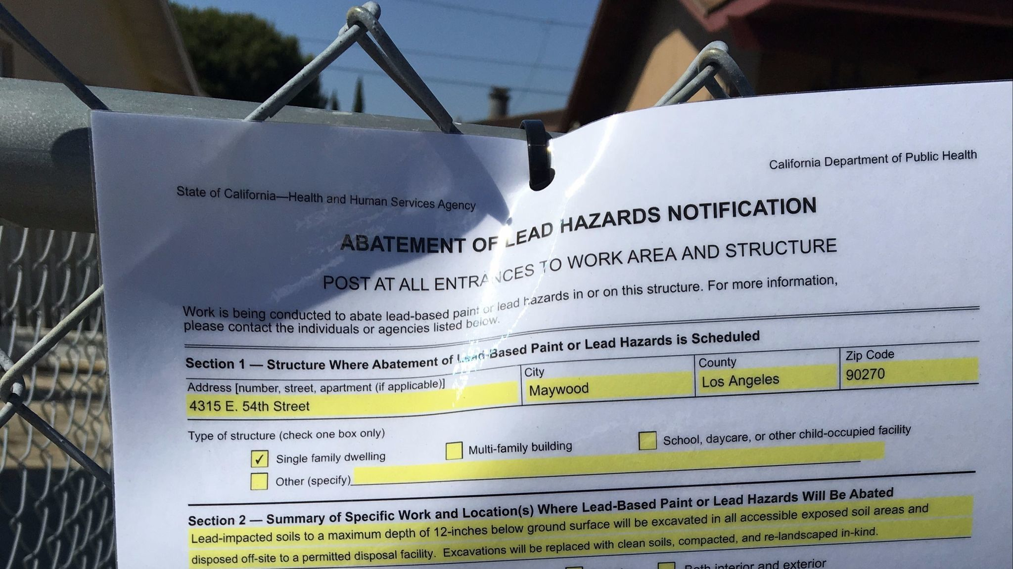 Lead hazard notifications, such as this one seen May 18 outside a home in Maywood, must be posted outside soil cleanup sites.