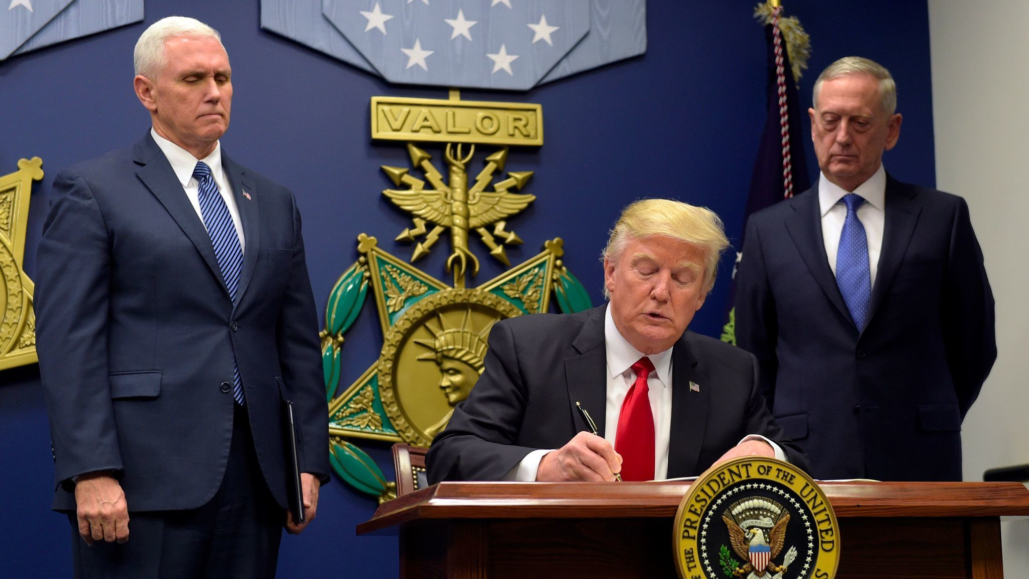 President Trump signs the original travel ban executive order on Jan. 27, 2017.