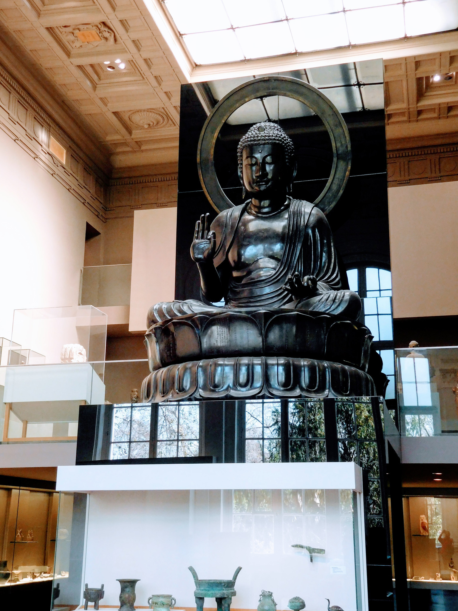 A two-story Japanese Buddha at the Musee Cernuschi in Paris' 8th arrondissement.. .