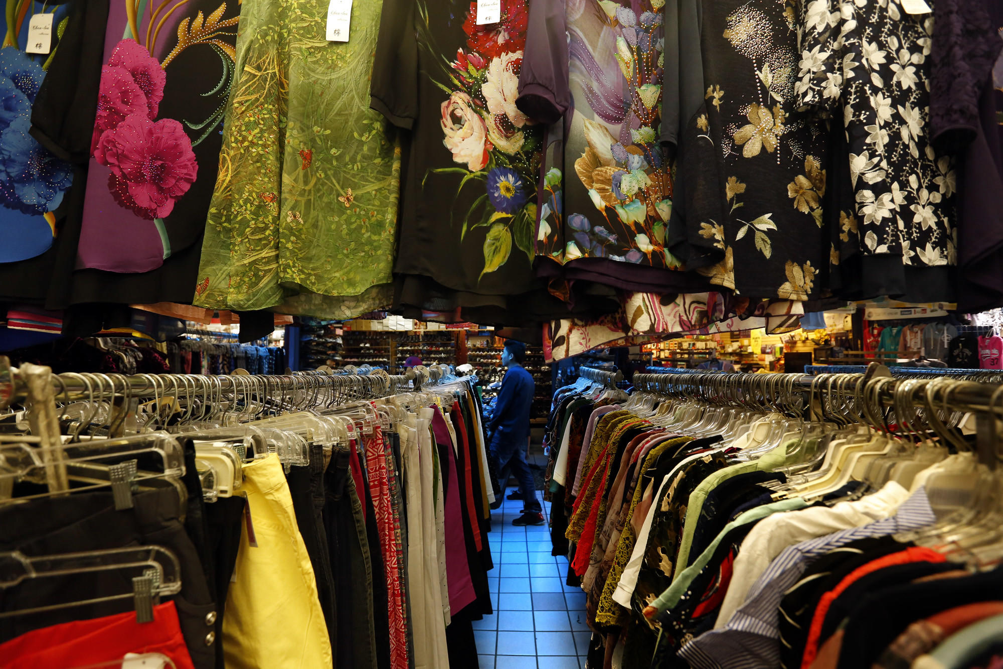 4e58cd1db41 A shopper is framed by clothing for sale at the swap meets in Chinatown.  (Genaro Molina   Los Angeles Times)