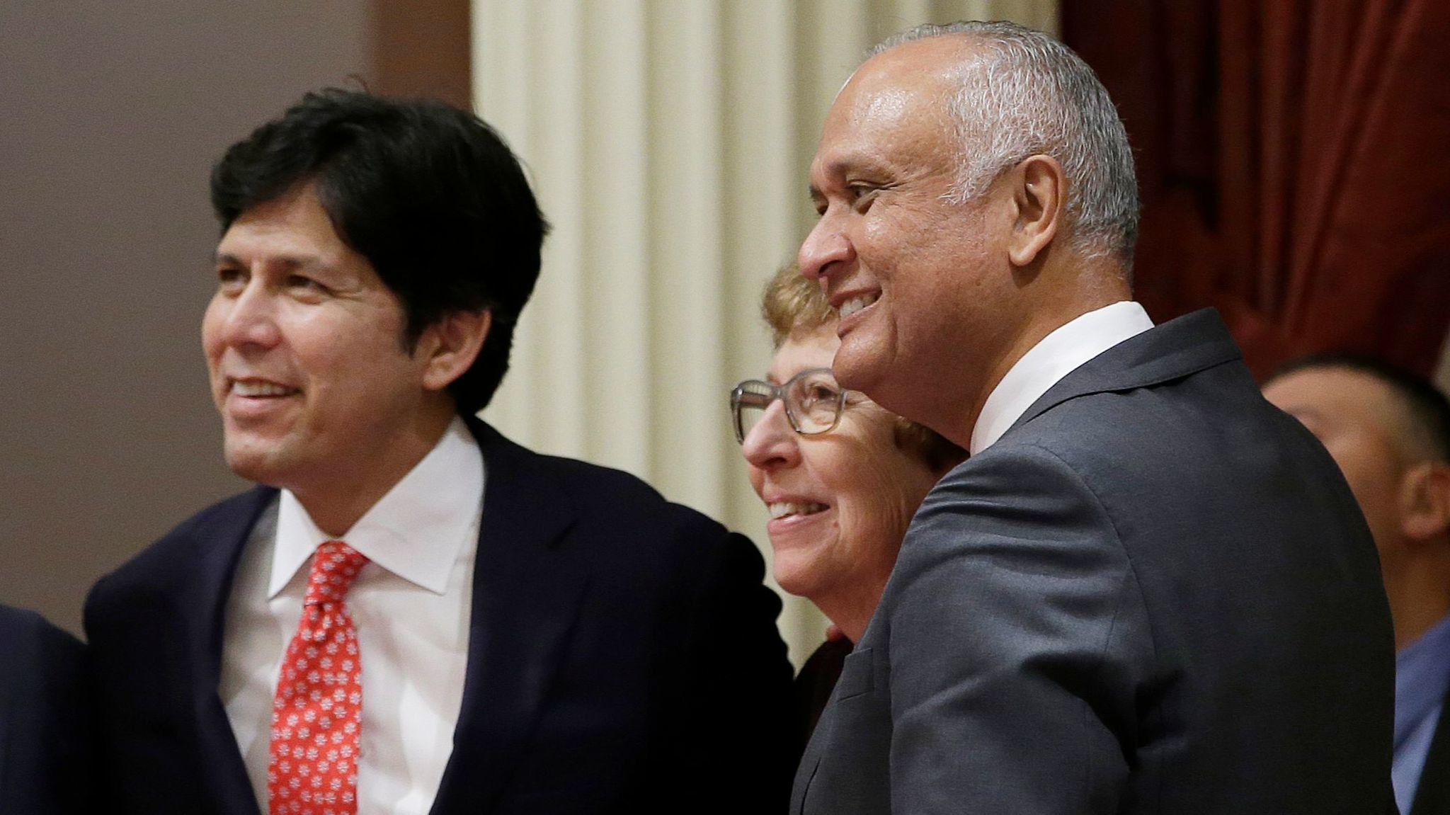 State Sen. Ed Hernandez of Azusa, right, smiles as he joins Senate President Pro Tem Kevin de León and then-Sen. Lois Wolk of Davis in 2016.