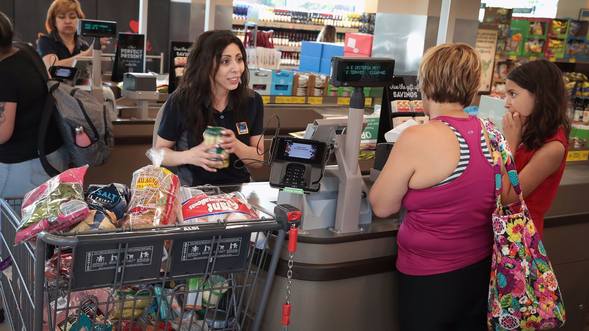 Customers shop at an Aldi grocery store in Chicago on June 12.