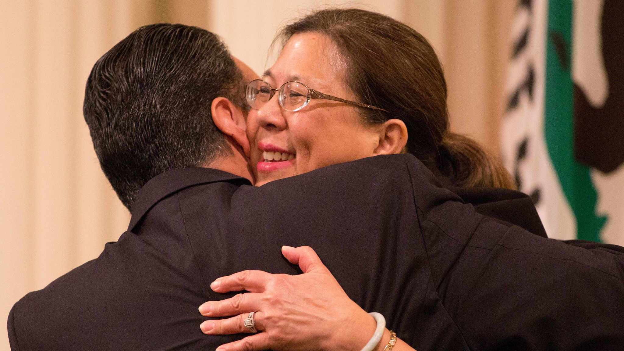 State Controller Betty Yee greets a lawmaker during a joint session of the California Legislature in 2016.