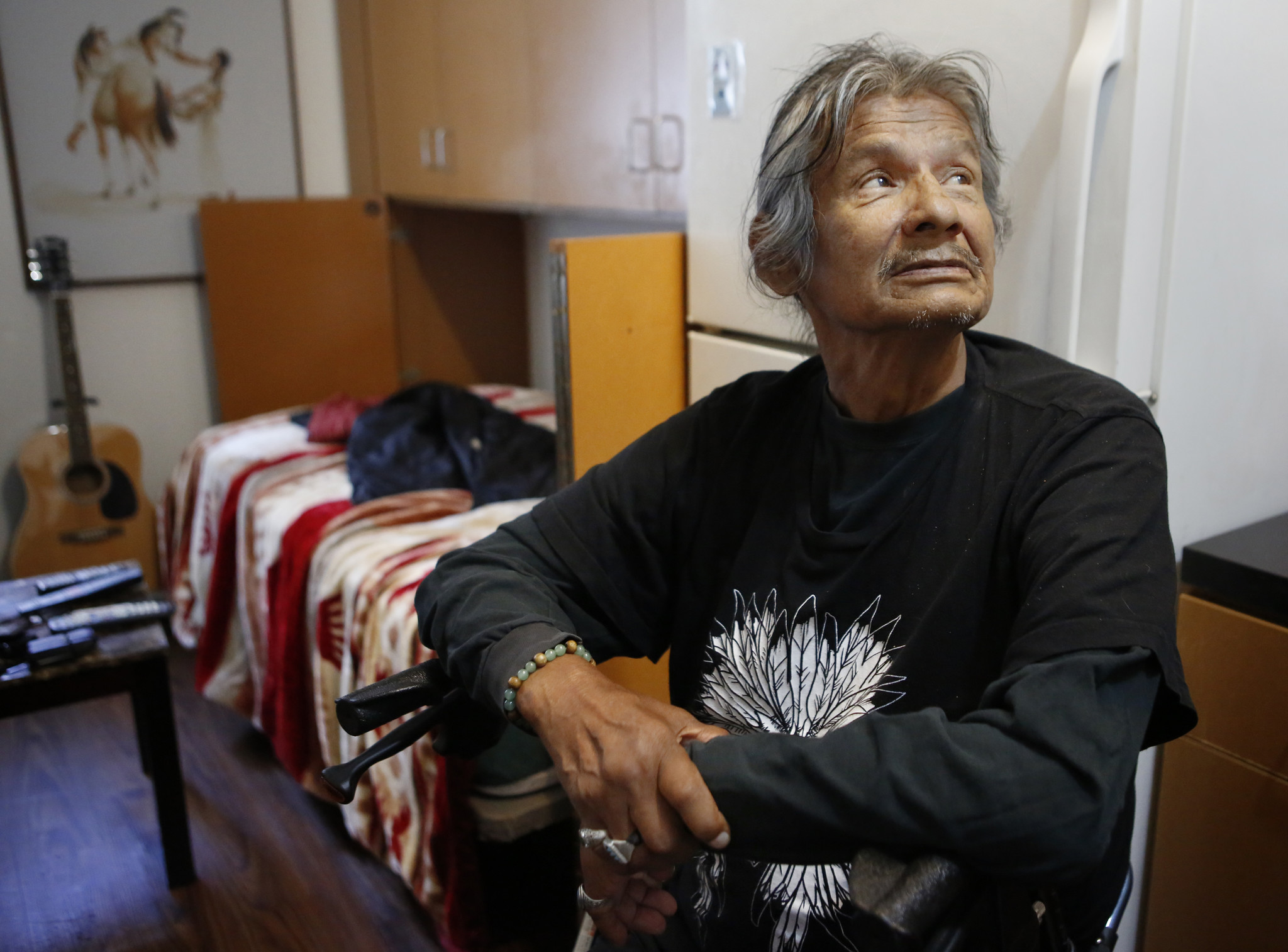 Richard LaRush, 65, in his apartment at Step Up on Second.