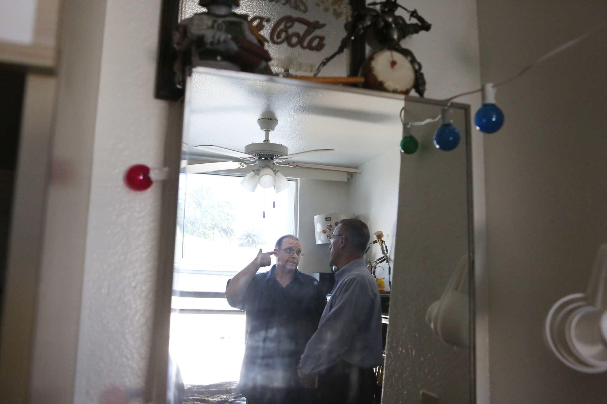 Theo Robin, left, discusses his life with Pennsylvania Rep. Timothy F. Murphy at Robin's apartment.