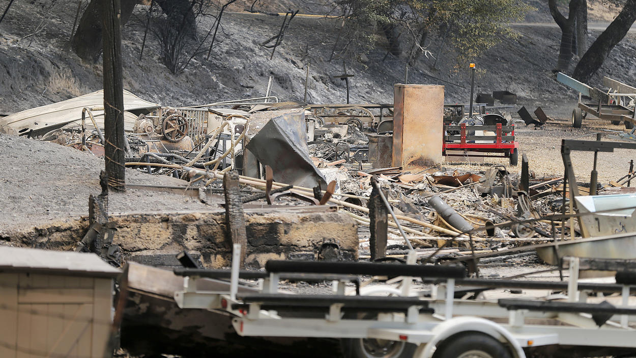 The remains of a structure and boats scorched by the Whittier fire sit along State Route 154 in Los Padres National Forest near Lake Cachuma in Santa Barbara County.