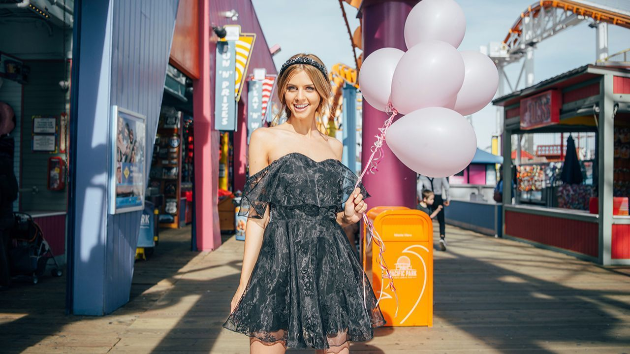 """Fast-fashion Australian brand Showpo makes on-trend pieces across every fashion category. The brand got a boost in the U.S. after its capsule collection for Coachella took off. Here is a black off-the-shoulder short-skirted """"Evening Star"""" dress, $61.95 at showpo.com."""