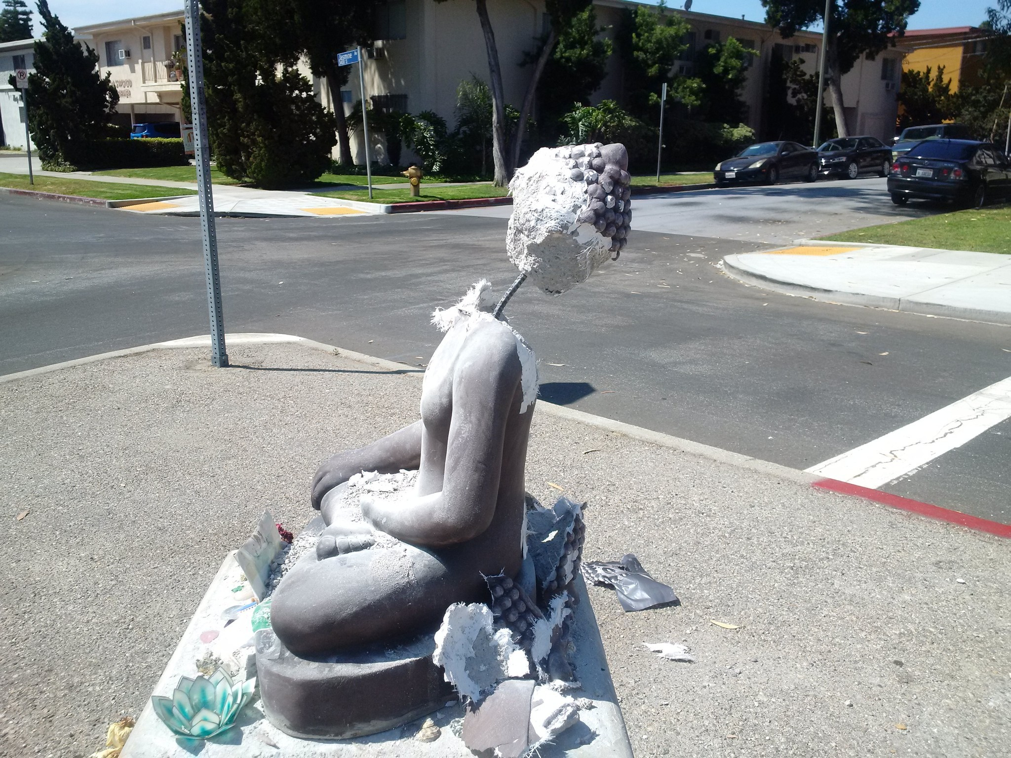 After several attempts, the vandal nearly decapitated the Buddha statue. Residents say they plan to replace it with a third one, but it will be made from metal.