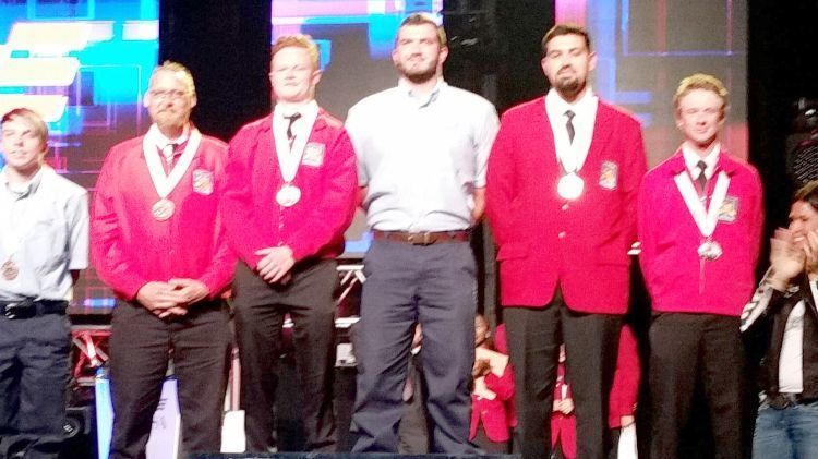 Seth Levy stands far right on SkillsUSA podium.
