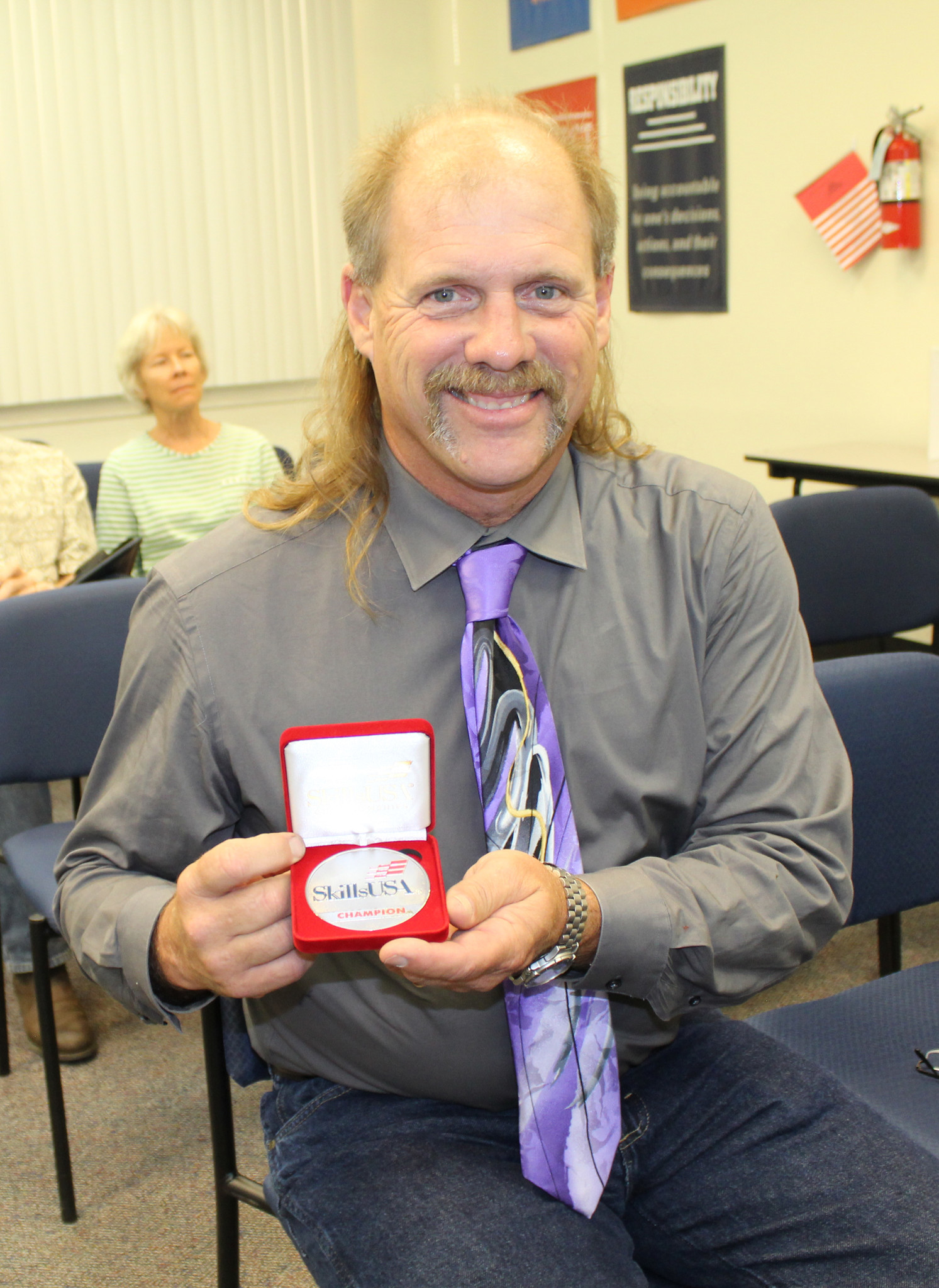 Ramona High School teacher Robert Grace shows the silver medal that Seth Levy earned at national SkillsUSA competition this summer.