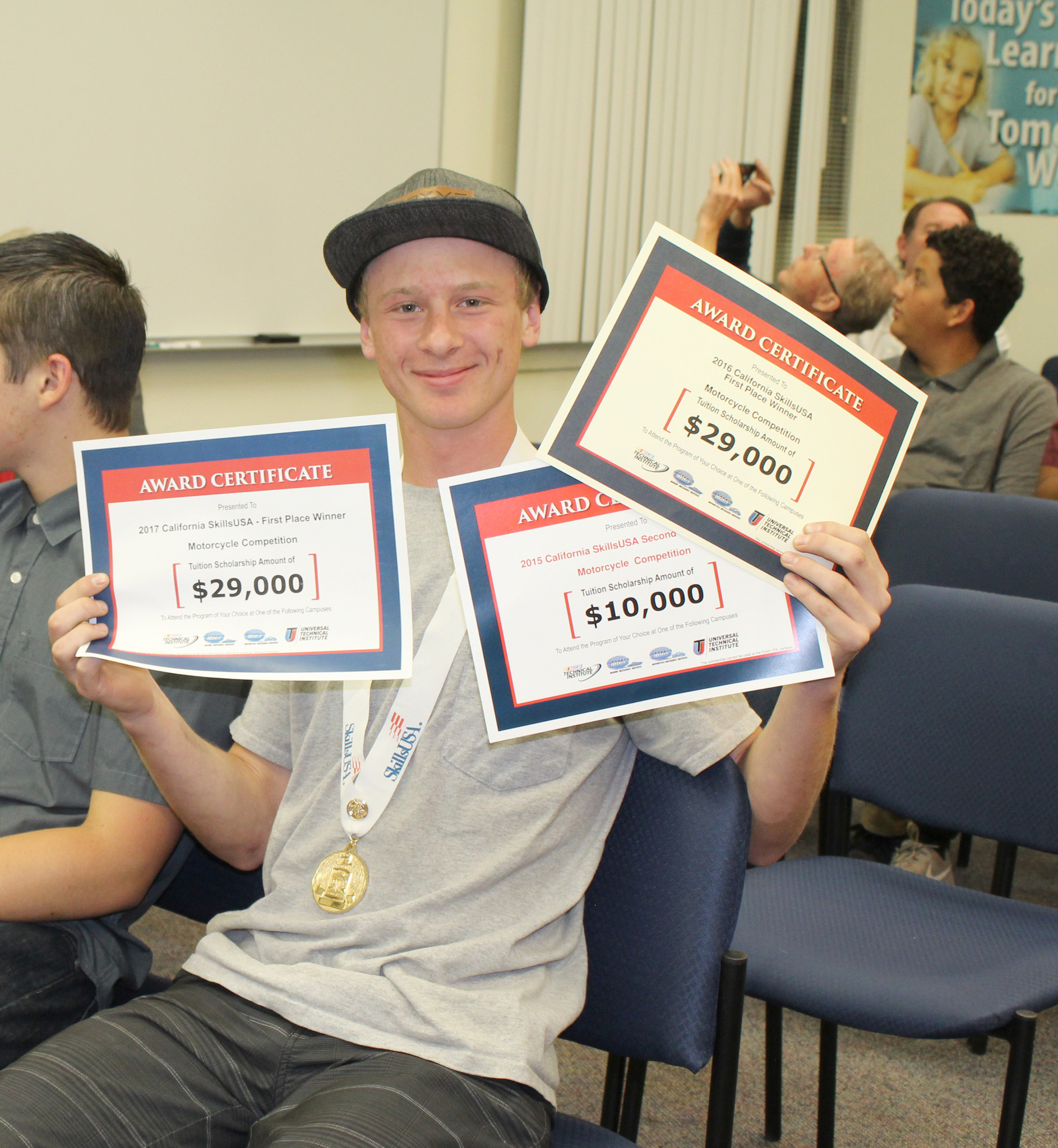 During a recent school board meeting, Seth Levy shows scholarship award certificates he earned in California SkillsUSA competitions in 2015, '16, and '17.