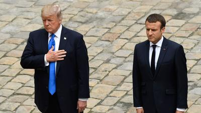 Trump in Paris defends son's meeting with Russian lawyer
