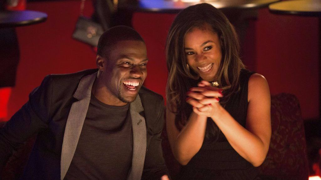 "Bernie (Kevin Hart) and Joan (Regina Hall) flirt on their date in the movie ""About Last Night."""