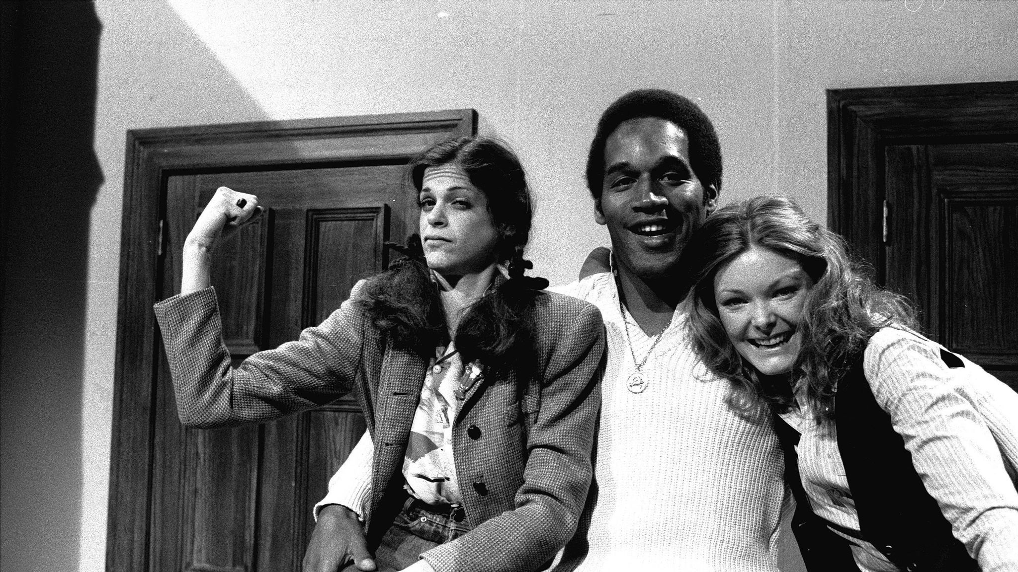 O.J. Simpson, center, poses with actresses Gilda Radner, left, and Jane Curtin while appearing on NBC's