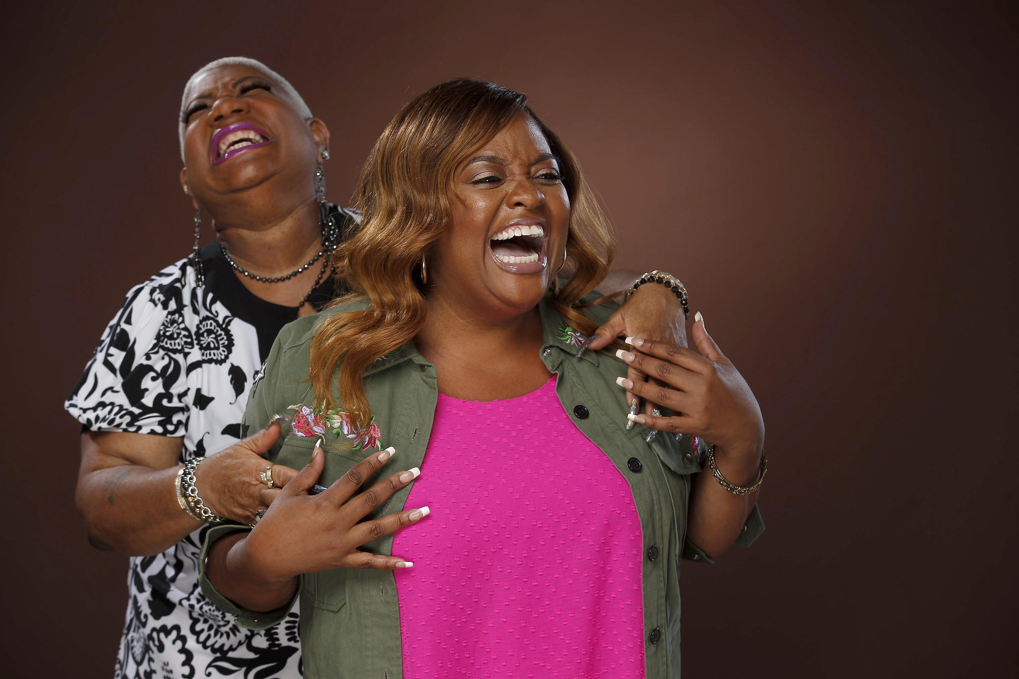 Luenell Campbell, known professionally as Luenell, and Sherri Shepherd laugh together during a photo shoot with the L.A. Times.