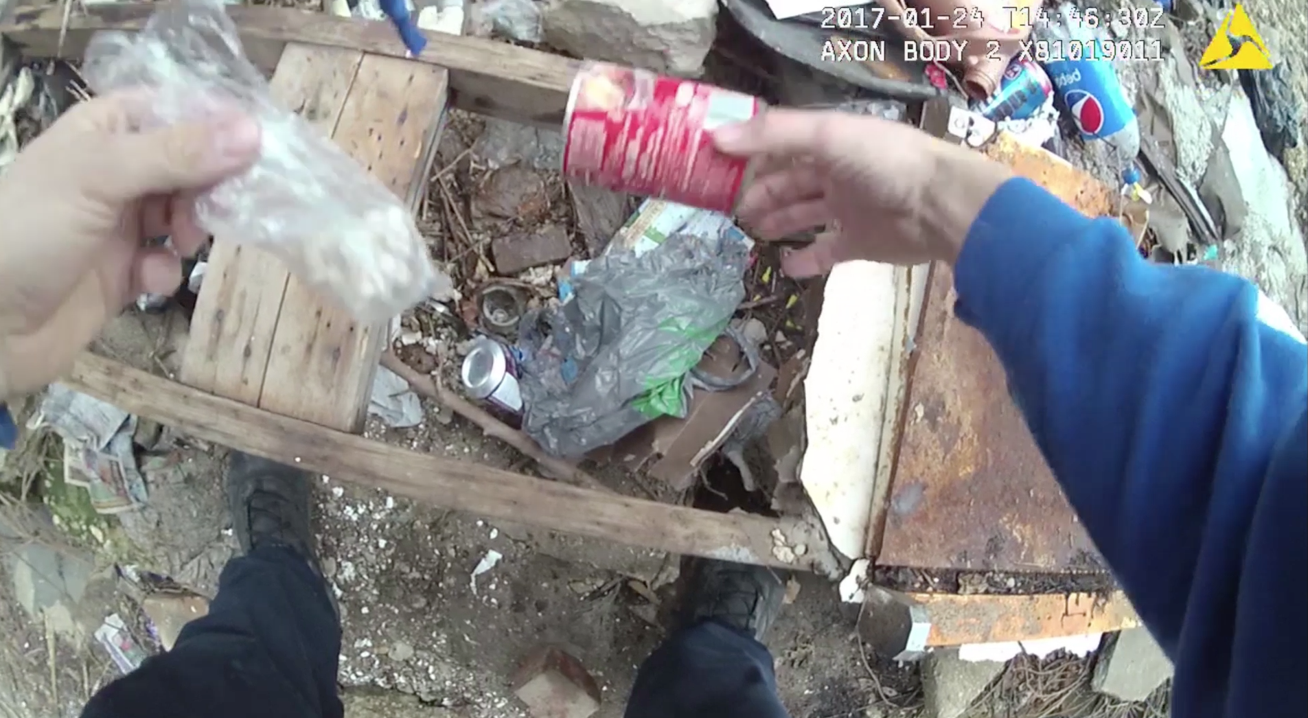 Body camera footage shows officer planting drugs, public defender