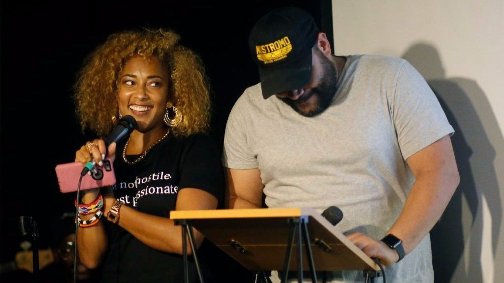 """Comedian Amanda Seales, left, and Colton Dunn laugh during """"Smart, Funny and Black."""""""
