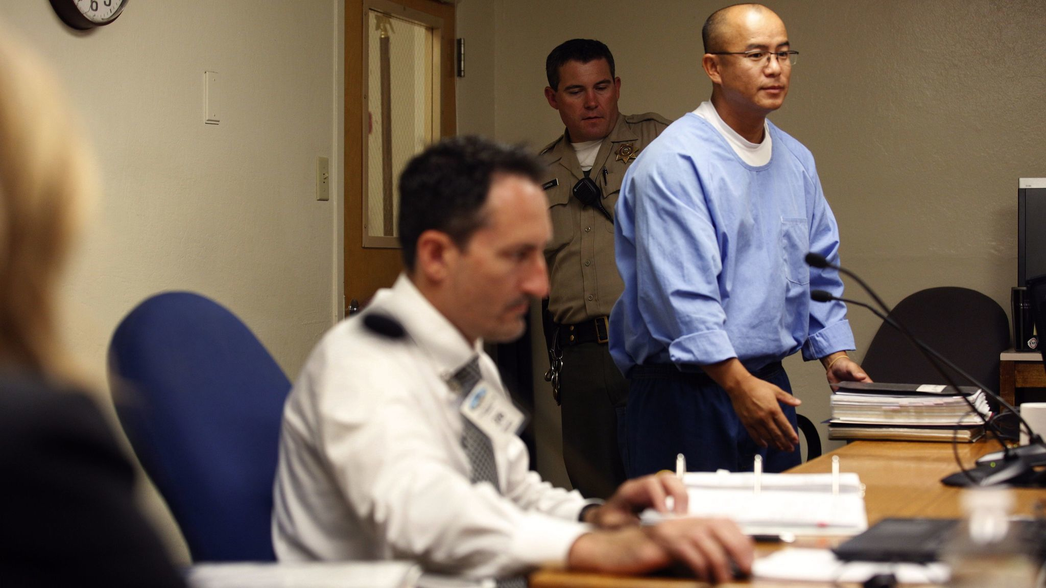 State inmate Kao Saelee, right, arrives for his initial suitability hearing in June before a three-member panel from the California Board of Parole Hearings.