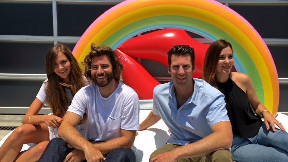 From left, Celeste Barrett, her husband Max Barrett, Blake Barrett and wife Raquel Barrett sit on their 'rainbow cloud daybed' pool float in Venice. The brothers and their wives founded Funboy in 2015. Then a Taylor Swift Instagram selfie with their pool floats went viral.