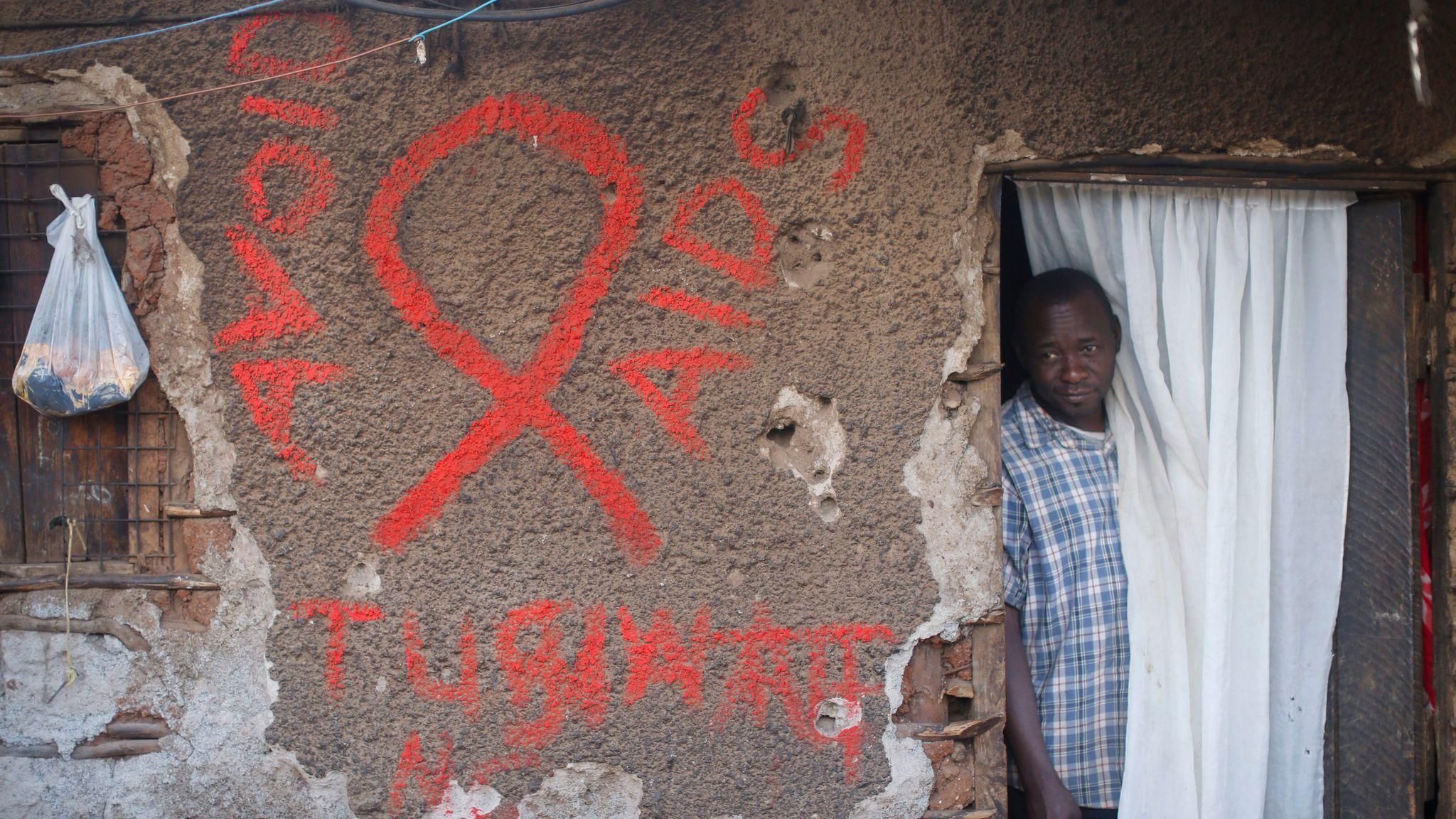 A man exits his home in the Kibera slum of Nairobi, Kenya.