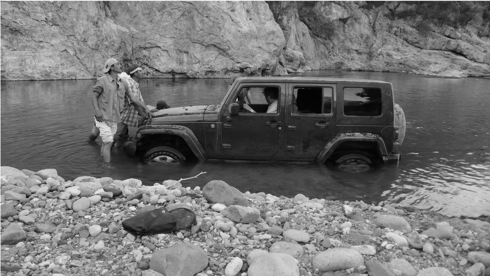 Martin's jeep, stuck in a riverbed.