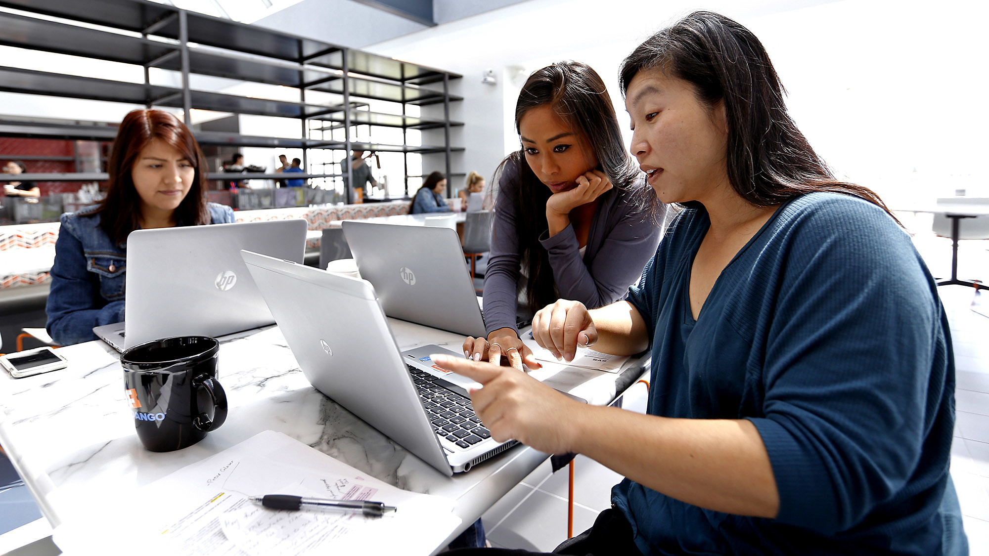 Amy Garcia, left, Leslie Chen and Waisze Lam work at Rotten Tomatoes and Fandango offices in Beverly Hills. Rotten Tomatoes continues to grow under the Fandango corporate umbrella.