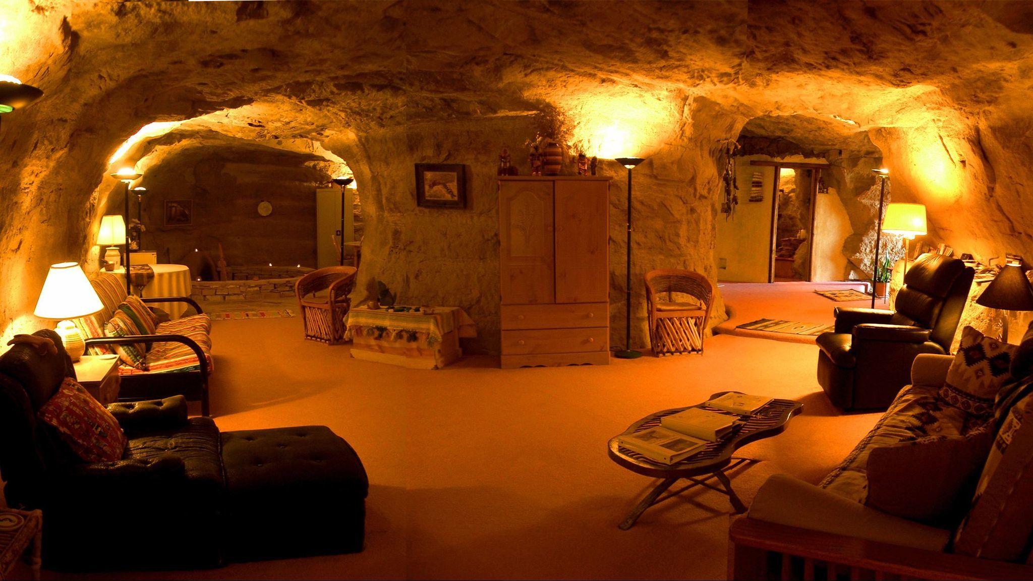 The man-made Kokopelli's Cave features multiple arches and room to relax. The exterior offers wide open views of the surrounding area.